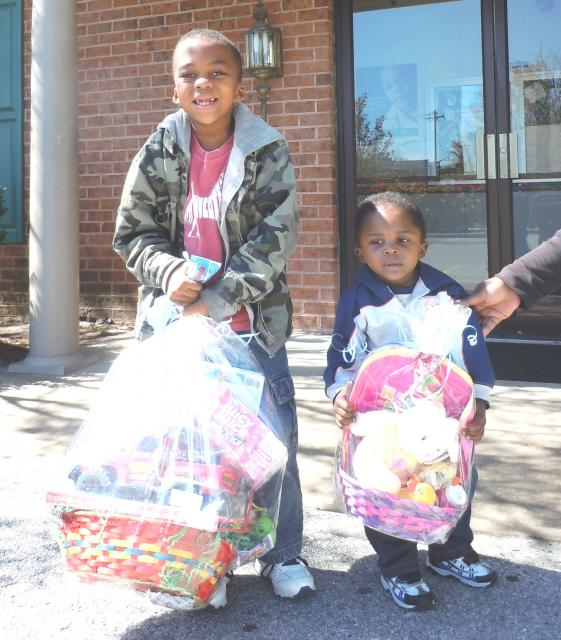 two kids hold gift baskets in Maryland