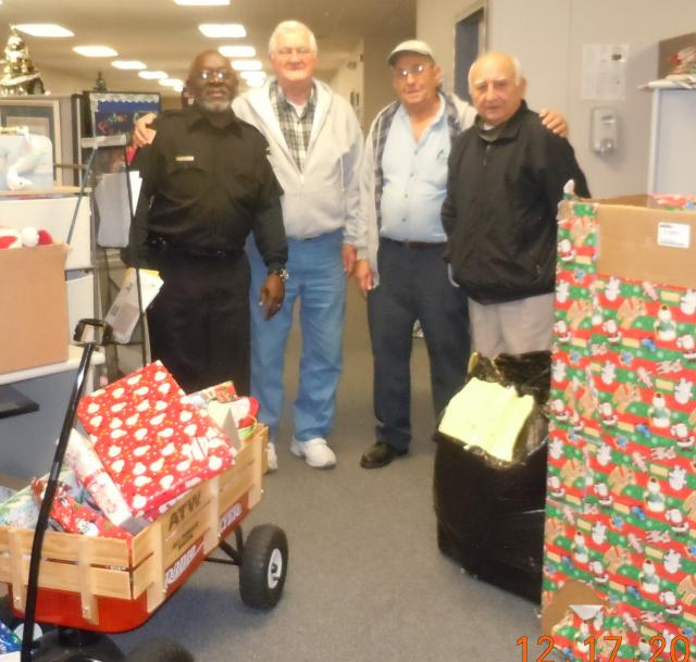 Volunteers with wagon of holiday gifts from Worcester County Gold MD