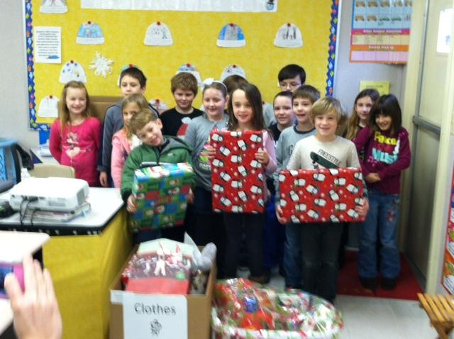 children pose with christmas gifts from Worcester County Gold MD