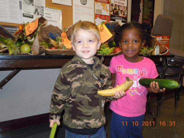 two children holding fresh vegetables at Woman speaking at bayside skillet on behalf of Worcester County Gold MD event