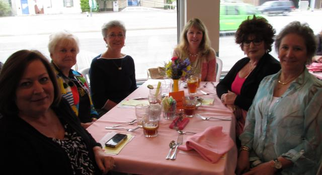 six women sitting and drinking at table for Worcester County Gold MD