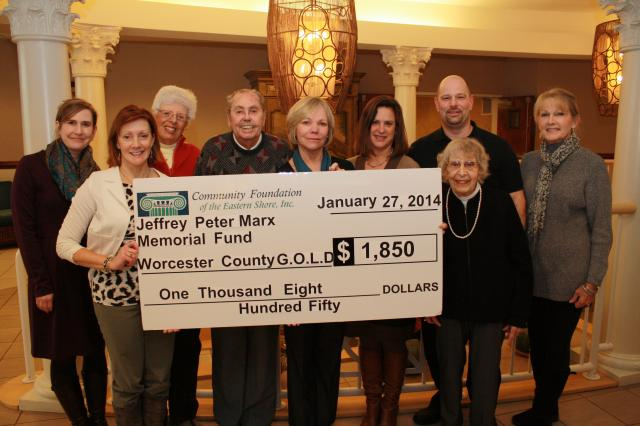 10 people holding a giant check to Worcester County Gold MD